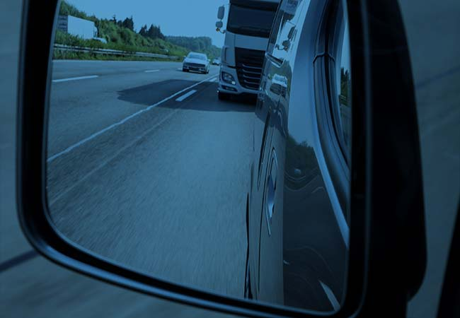 picutre of a big rig in side view mirror